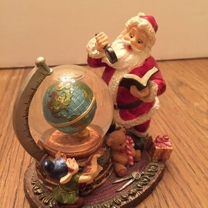 Santa With Globe Planning His Route